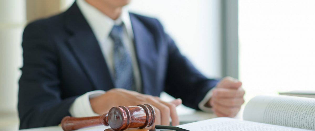 Lawyer with gavel and paperwork